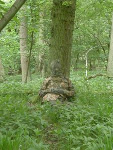 The Badger Watching Man in full camouflage clothing
